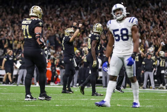 New Orleans Saints quarterback Drew Brees (9) celebrates after breaking the NFL all-time passing touchdown record during the third quarter of the game against the Indianapolis Colts at Mercedes-Benz Superdome in New Orleans on Monday, Dec. 16, 2019.