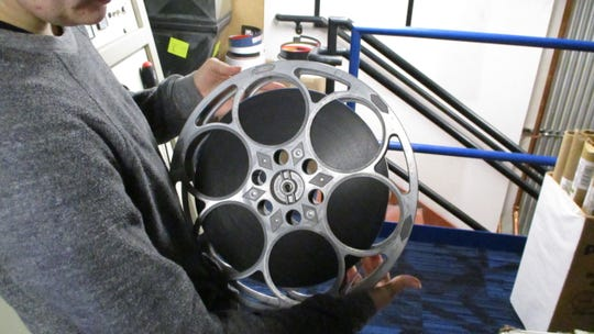 """A projectionist at FilmScene displays one reel of film which holds about 17 minutes of movie. Both """"It's a Wonderful Life"""" and """"Little Women,"""" use about seven reels of film to project their run time."""