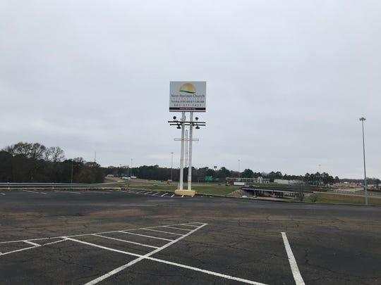 Sign on parking lot of New Horizon Church  International