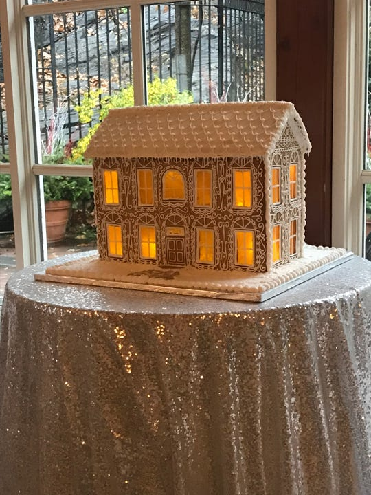 One large gingerbread house that was lighted and had windows of butterscotch was auctioned for $800.