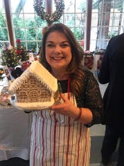 Cookie artist Karen Knapp, owner of KJ Cookies, is proud of her gingerbread house that was commissioned for a benefit in New York City.
