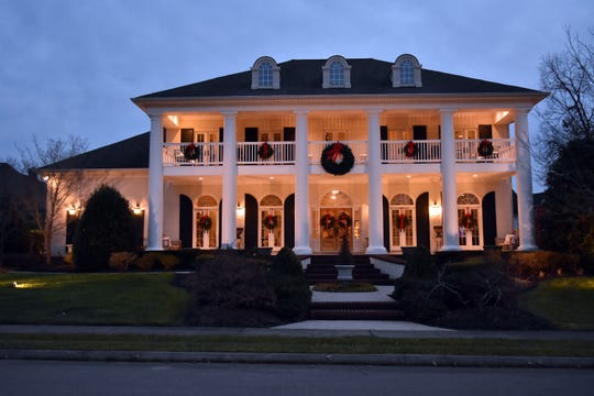 The Dockery home lights up under the night sky.