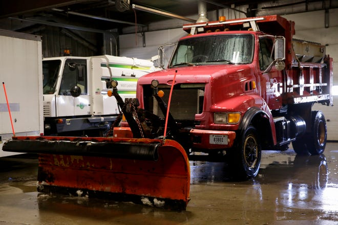 A snow plow sits in a West Lafayette Streets and Sanitation garage, Tuesday, Dec. 17, 2019 in West Lafayette.