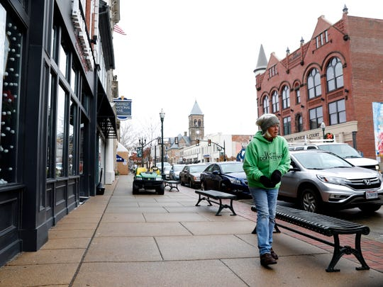 Margie Kunkler, downtown beautification specialist, searches for litter as she walks Tuesday, Dec. 17, 2019, through downtown Lancaster.