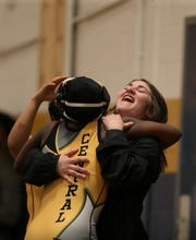 Santanna Holland hugs Prisca Sebele after winning her wrestling match at Fairdale High School on Dec. 7, 2019.