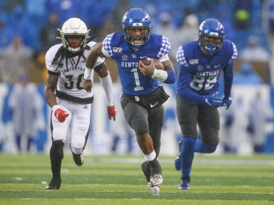 A determined UK's Lynn Bowden Jr. sprints down the field for another touchdown in the second half to bury Louisville at Kroger Field on a rainy Saturday afternoon. Nov. 30, 2019