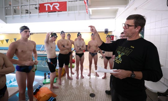 St. X head coach Todd Larkin gives instructions to his swim team during practice at the school in Louisville, Ky. on Dec. 16, 2019.