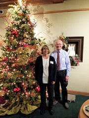 Bob Kellner and Mary Zboralski with the tree they decorated in the Central Gallery this year during Christmas in the Mansion at Rahr-West Art Museum in Manitowoc.