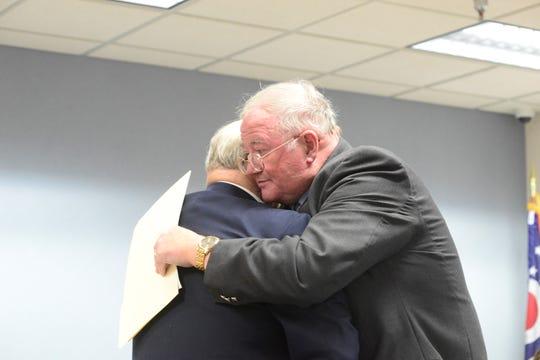 Richland County Commissioner Darrell Banks embraces Lexington Mayor Gene Parkison.