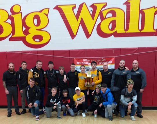 Head coach Scott Carr (third from right, back row) saw his Northmor Knights win the Big Walnut Invitational last weekend behind Outstanding Wrestler Conor Becker (holding trophy).
