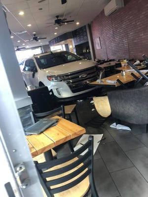 An SUV drove through the doors of Crave Coffee Shop, shattering glass and scaring those inside. Two minors had non-critical injuries.