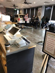 An SUV drove through the doors of Crave Coffee Bar and Bistro in Arlington Tuesday, shattering glass and plunging into the coffee shop.