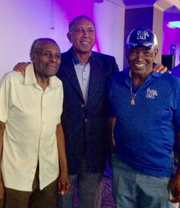 Longtime Memphis basketball supporter Rodell Boyd (left) and his best friend, Alfred Harrison (right), pose for a picture with former Tiger coach Tubby Smith.