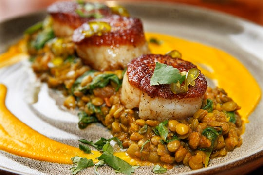 Twisted Fire in Oconomowoc, a restaurant with a wood-fired hearth, changes its menu seasonally, switching up the accompaniments for scallops, for instance.