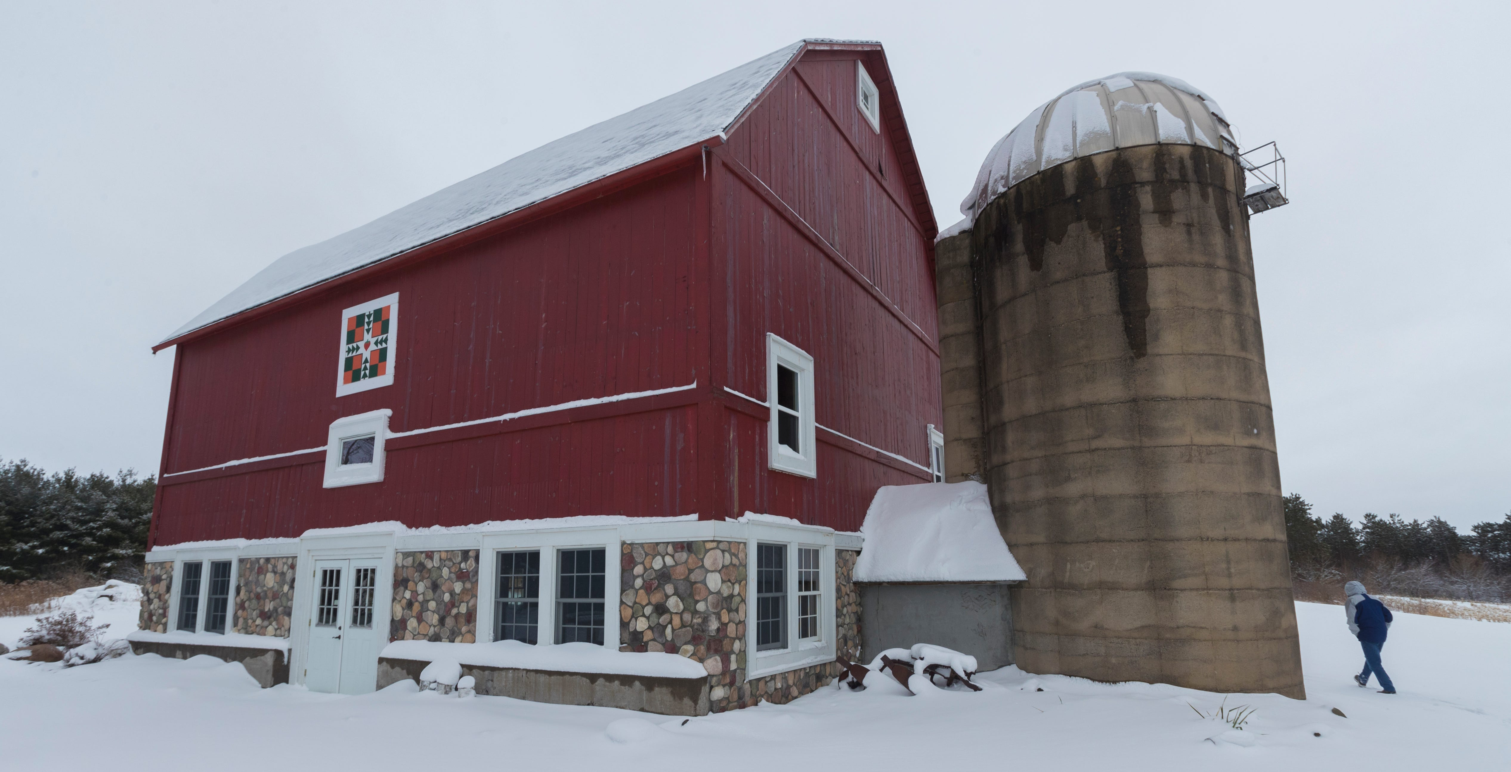 Former dairy farmer Greg Zwald walks to the renovated barn he uses as an event space at his White Pine Berry Farm.