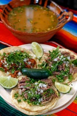 Lamb consomme with lamb tacos on the side is one of many menu items at El Tlaxcalteca on the south side.