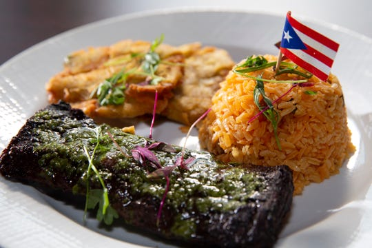 Sabor Tropical restaurant in Bay View serves a pan-Latin menu that includes a number of Puerto Rican dishes. Sometimes, cuisines mix on one plate, as in this Argentine-style steak with chimichurri sauce that's served with Puerto Rican rice and plantain.