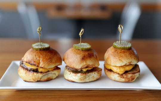 Sliders made from grass-fed beef are on the menu at the casual Public Table, a modern corner bar in West Allis.