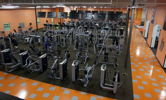 Clients work out in the main room at Xperience Fitness in Waukesha in October 2015. The fitness center is one of many new gyms that have opened in Waukesha.