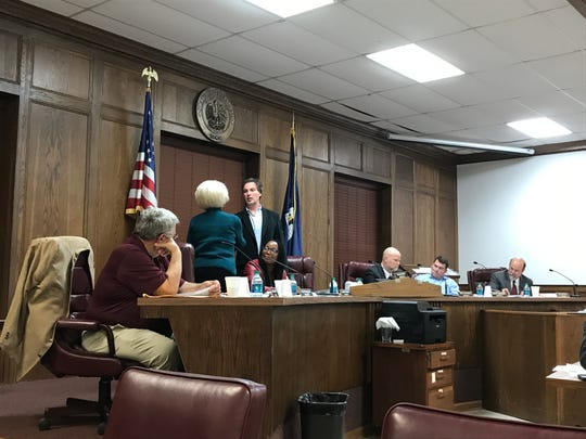 Police Jury President Shane Smiley presents Kay Kellogg Katz a plaque to honor her time serving on the Ouachita Parish Police Jury on Monday.