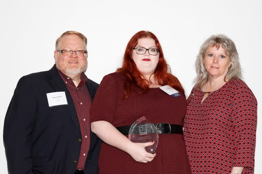 Logan Stewart Guarino, center, Goodwill's store manager in Smyrna, was honored as an Achiever of the Year at the nonprofit organization's annual Impact Luncheon in Nashville. Also pictured are her parents, Roger Stewart, the deputy director for the National Alliance on Mental Illness in Tennessee, and Denise Stewart, a volunteer education coordinator for NAMI.