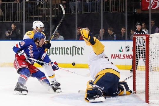 New York Rangers left wing Brendan Lemieux (48) collides with Nashville Predators defenseman Dan Hamhuis (5) as he takes a shot on Nashville Predators goaltender Juuse Saros (74) during the second period on Monday, Dec. 16, 2019, in New York.