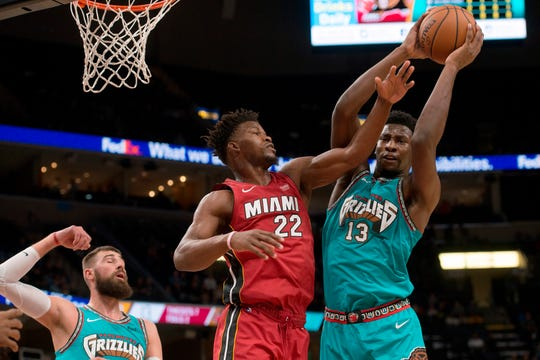 Memphis Grizzlies forward Jaren Jackson Jr. (13) grabs a rebound against Miami Heat forward Jimmy Butler (22) in the first half Monday in Memphis.