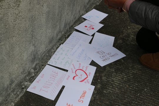 Two Battle Ground Academy students taped dozens of cards with encouraging messages on the Natchez Trace Bridge on Dec. 7, 2019.