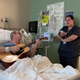 """Brandi Leath shared a touching video of her father, Penn Pennington, and his nurse, Alex at Sarah Cannon Cancer Center singing """"O Holy Night."""" Pennington played guitar at the Grand Ole Opry for over twenty years with Jack Greene."""