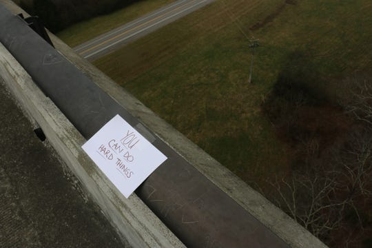 Two BGA students placed messages of encouragement and hope on the Natchez Trace Bridge on Dec. 7, 2019.