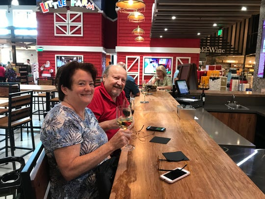 Monica and Lloyd Rawn at one of the four spots to enjoy an adult beverage while shopping or taking a break at the new Oakes Farm Seed to Table Market.
