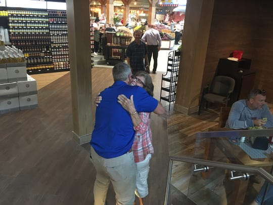 Market owner Alfie Oakes with his proud mom, Wendy, who said she cried as she walked her son's store at Tuesday's opening.