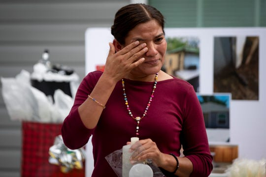 Virginia Herrera wipes away a tear after thanking God and every person and organization that has helped her and her husband over the past two years during the dedication ceremony for their new house, which was built through the support of the Immokalee Unmet Needs Coalition, in Immokalee on Tuesday, December 17, 2019.