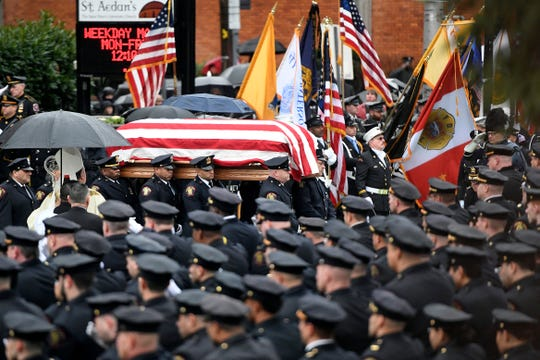 Jersey City police officers carry the casket of Detective Joseph Seals out of St. AedanÕs Church on Tuesday, Dec. 17, 2019, in Jersey City. Seals was one of four victims killed by two shooters on Tuesday, Dec. 10.