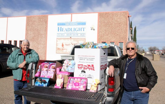 Deming-Luna County Toys for Tots Coordinator Thom Barry (at right) and assistant coordinator Dick Hoezee are prepared to ship a new batch of toys to the storage facility on Monday.