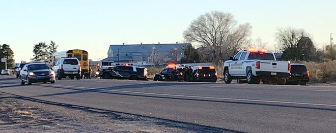 This photo captured late Monday afternoon shows a Deming school bus and New mexico State Police units, along Luna County Sheriff's vehicles at Columbus Highway near the intersection of Hood Road.
