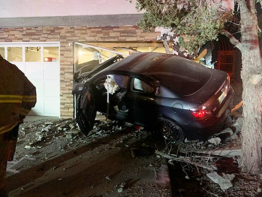 The vehicle driven by Chad Erickson crashed into Peter Cruz's house on Thursday, Dec. 12, 2019.