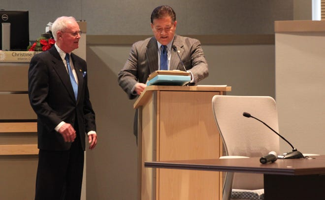 City Councilor Jack Eakman, left, receives thanks and an engraved plate from Mayor Ken Miyagishima during Eakman's last city council meeting on Dec. 16, 2019.
