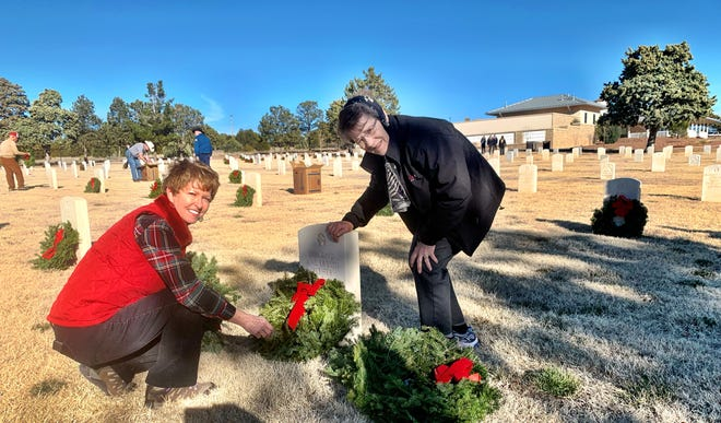 Doña Ana Daughters of the American  Revolution Susie Coker, left and Linda Bartlett place wreaths at Fort Bayard Cemetery in Grant County on Friday, Dec. 13, 2019.