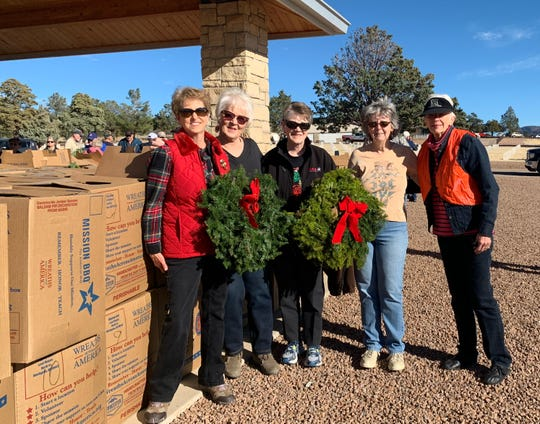 Doña Ana Daughters of the American Revolution members Susie Coker, from left, Mary Lee Shelton, Linda Bartlett, Jeannie Kowalik, and Mary Cowan, the Fort Bayard Cemetery Wreaths Across America project coordinator.