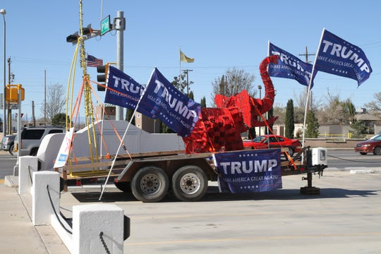 A trailer holding a red elephant and festooned with flags indicating support for President Donald J. Trump sat in the parking lot of the Tularosa Basin Museum of History on Tuesday morning.
