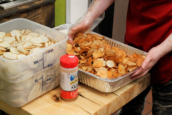 Freshly made potato chips are being prepared to be served at Mama's Deli in downtown Farmington on Dec. 16, 2019.