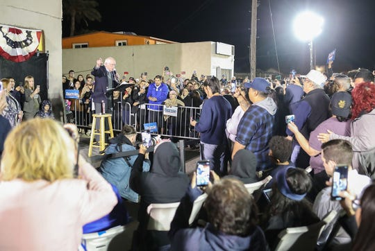 Bernie Sanders addresses a crowd during a brief campaign rally in Coachella, December 16, 2019.