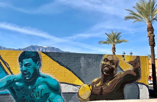 This mural is painted on the side of One Eleven Conditioning Club, a fitness center in downtown Cathedral City. It is located at 68-571 E. Palm Canyon Drive.