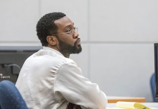 Efidarius Bryant listens to opening statements during his trial in Pensacola on Tuesday, Dec. 17, 2019.  Bryant stands accused of killing QuickFill Gas Station clerk Govardhan Kotha.