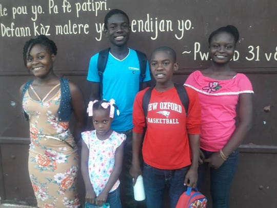 In December, the small school that Micka, Compere, Nerlande, Alex and Abigaelle attend opened after being closed for 11 weeks because of gang violence. They wore regular clothes instead of their school uniforms to not draw attention to where they were going.