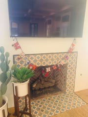 Tabarka tile is displayed on the fireplace in the kitchen.
