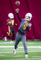 Arizona State University quarterback Jayden Daniels fires a pass during practice at the Verde Dickey Dome on campus in Tempe, Tuesday, December 17, 2019.