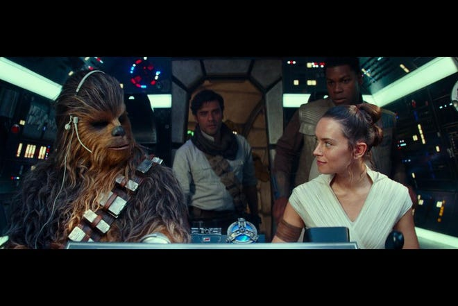Chewbacca (Joonas Suotamo), Poe (Oscar Isaac), Finn (John Boyega) aboard the Millennium Falcon in 'Star Wars: The Rise of Skywalker.'