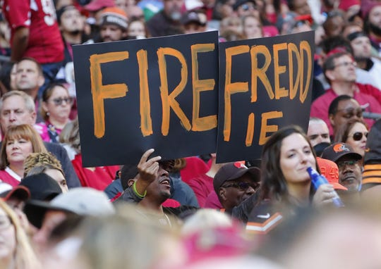 A Cleveland Browns fan holds a sign in reference to Cleveland Browns head coach Freddie Kitchens during the second quarter against the Arizona Cardinals at State Farm Stadium December 15, 2019.